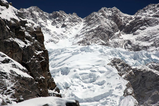 View of camp 3. (taken from 6000m): the C3 is on the top of the plateau, above the crevasses. The Kangch summit is on the left, above the rock wall that is in front. Photo: Philippe Gatta